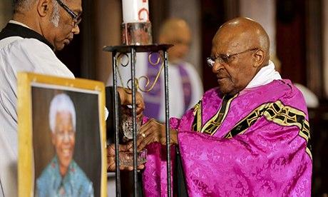 Tutu offering prayers for Madiba